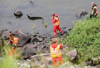 Pelastustyöntekijät tuhojen jäljillä Oslossa 24. heinäkuuta 2011.