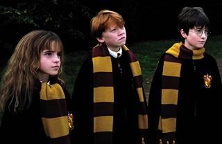 Emma Watson, Rupert Grint ja Daniel Radcliffe elokuvassa Harry Potter ja viisasten kivi.