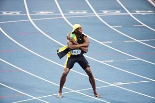 Usain Bolt oli Rion olympiastadionin juoksuradan kuningas.