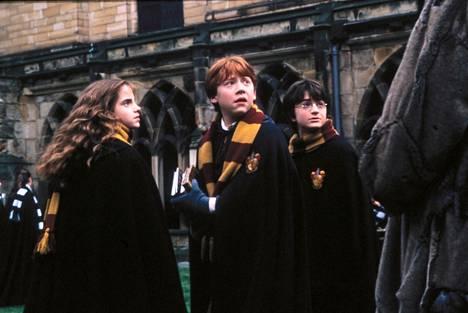 Grint näytteli Ron Weasleyta (kesk) menestyselokuvissa.