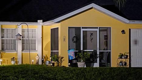 TV-kuvausryhmien valot valaisivat Brian Laundrien kotitaloa sunnuntaina.