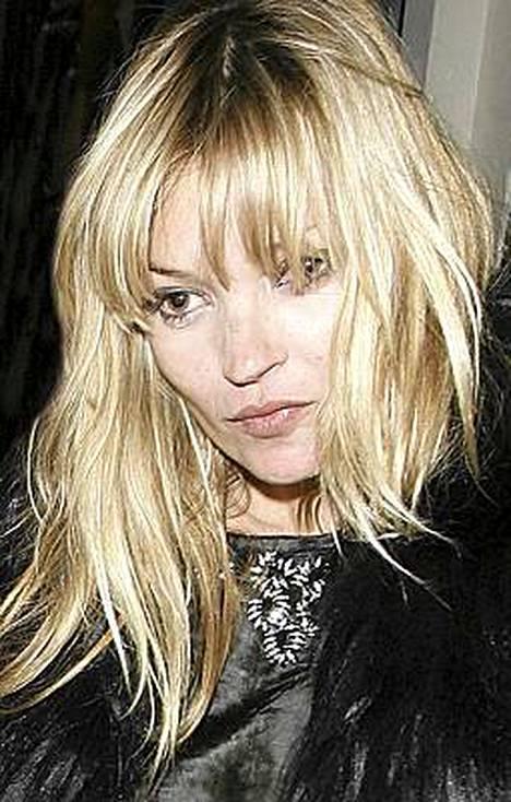 Kate Moss aikoo jättää juhlat taakseen.