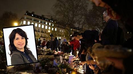 Ihmiset ovat sytyttäneet kynttilöitä ja tuoneet kukkia valtasti Bataclanin konserttisalin edustalle.