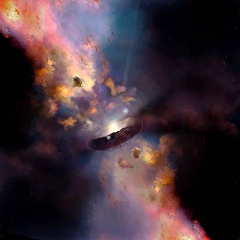 """Havainnekuvan keskellä oleva musta rengas on tiheä kaasu- ja pölypilvi, joka ympäröi supermassiivista mustaa aukkoa. """"Donitsin"""" molemmin puolin on pyöreitä kaasupilviä, joiden liikkeitä Nevadan yliopiston tutkimus mallinsi."""