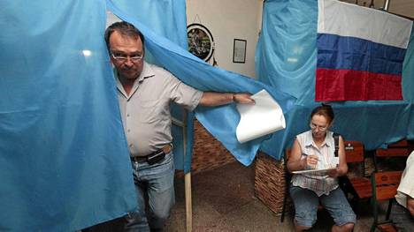 Venäjän lipun alla: Krimin aluevaalit sinetöivät presidentti Vladimir Putinin tukipuolueen Yhtenäisen Venäjän valta-aseman niemimaalla.