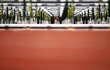 Paikoillanne, Valmiina... Hyleas Fountain lähtötelineissä seitsenottelun 100 metrin aitajuoksussa Yhdysvaltain olympiakarsinnoissa Eugenessa, Oregonissa. Fountain oli aidoissa toinen ajalla 12.86. Ensimmäisen päivän jälkeen hän johtaa kisaa. Neljän lajin jälkeen hänellä on pisteitä kasassa 3948.