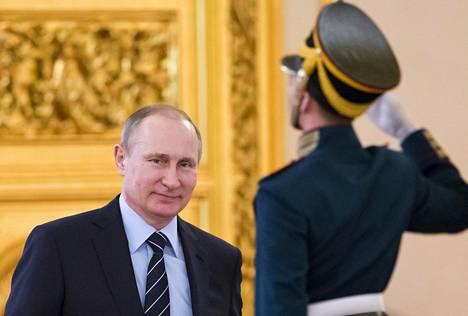 Vladimir Putin kuvattuna Kremlissä.