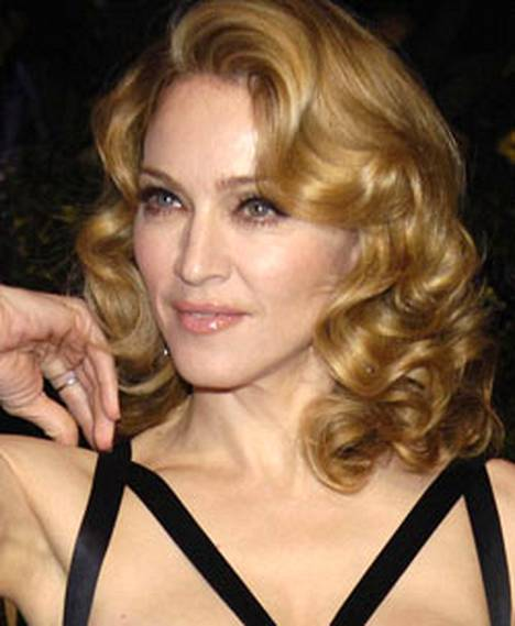 Madonna huutaa välillä kotonaan kurkku suorana.