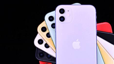 Applen iPhone-puhelimia. Omenalogon dominoiva takakansi on aktivoitavissa napiksi.