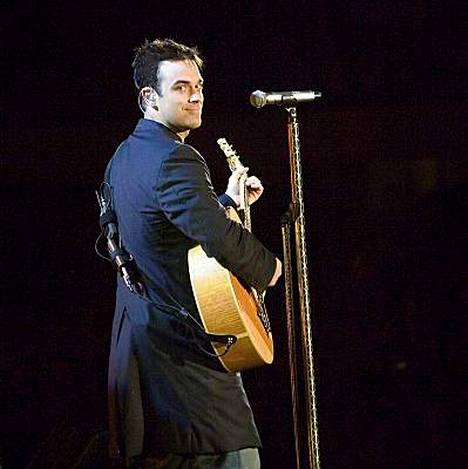 Robbie Williams palaa 20. lokakuuta konserttilavalle pitkän tauon jälkeen.
