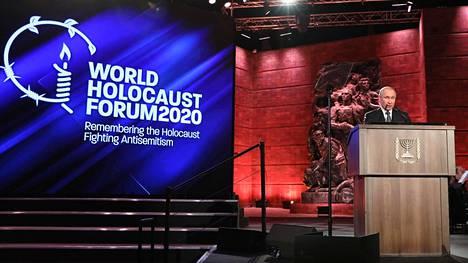Presidentti Vladimir Putin puhui holokaustin muistotapahtumassa Jerusalemin Yad Vashem -keskuksessa tostaina.