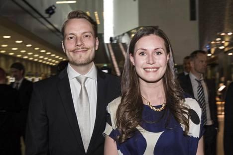 Sanna Marin ja miehensä Markus Räikkönen.