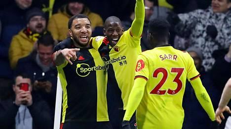 Watfordin Troy Deeney (vas.) juhli maaliaan Liverpoolia vastaan joukkuekaveriensa kanssa helmikuussa.