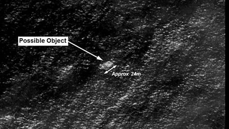 Onko tässä satelliittikuvassa lentokoneen osa?