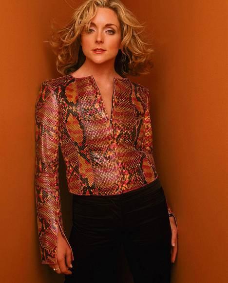 Jane Krakowski esitti sarjassa seksikästä ja loputtoman uteliasta Elaine-sihteeriä.