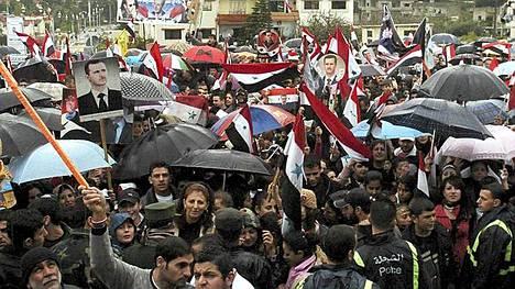 Syyrian presidentin Bashar al-Assadin kannattajat marssilla.