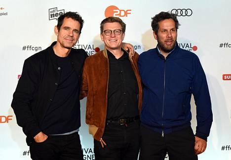 Babylon Berlin -sarjan ohjaajat Tom Tykwer, Hendrik Handloegten ja Achim von Borries.