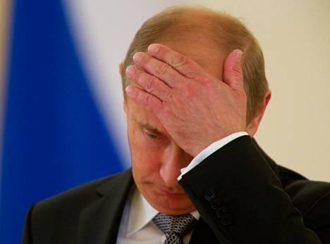 Vladimir Putin ja naamapalmu vuonna 2012.