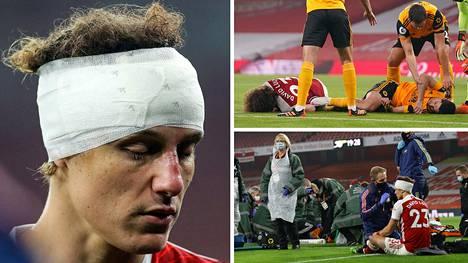 Arsenalin David Luiz jatkoi pelaamista, vaikka oli saanut rajun tälliin päähänsä yhteentörmäyksessä Wolvesin Raul Jimenezin kanssa.