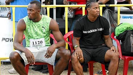 Usain Bolt (vas.) ja Yohan Blake kilpailivat heille ei niin tutulla matkalla.