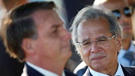 Brasilian talousministeri Paulo Guedes (oik) ja Brasilian presidentti Jair Bolsonaro.