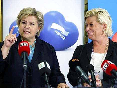 Erna Solberg (vas.) ja Siv Jensen.