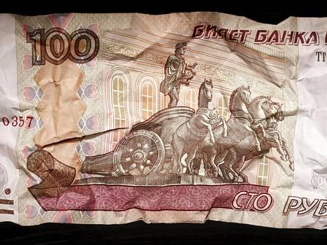 Sadan ruplan seteliä