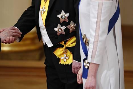 Presidentti Sauli Niinistön ja rouva Jenni Haukion kunniamerkit.
