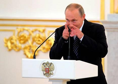 Presidentti Vladimir Putin puhui venäläisten olympiaurheilijoiden vastaanotolla Kremlissä viime viikolla. Venäjä on pitänyt dopingsyytöksissä ryvettyneiden urheilijoidensa sulkemista ulos olympialaisista suurena vääryytenä.