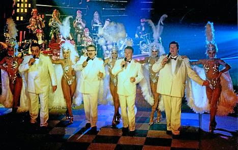 Vertaansa vailla Kivikasvojen Moulin Rouge -numero syksyn 1994 sarjassa. Kuvassa mukana Hot Club Dance Companyn tanssijattaria sekä Ladies First Big band.