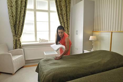 Myös hotellihuoneiden siivous ja imurointi sujuu Sanilta.