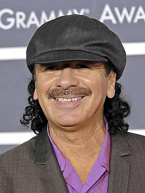 Carlos Santana on rakastunut mies.