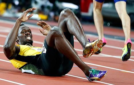 Usain Boltin ilme oli tuskainen, kun hän loukkaantui pikaviestin MM-finaalissa lauantai-iltana.