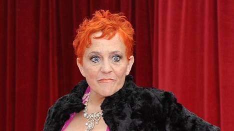 Kitty McGeever poseerasi punaisella matolla British Soap Awards -gaalassa vuonna 2011.