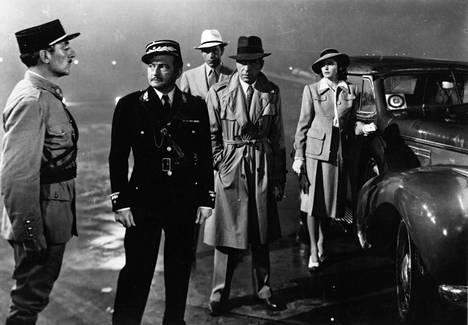 Bogart ja trenssi. Harva vaate on tyylillisesti kestänyt aikaa yhtä hyvin.