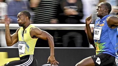 Tyson Gay (vas.) ja Usain Bolt