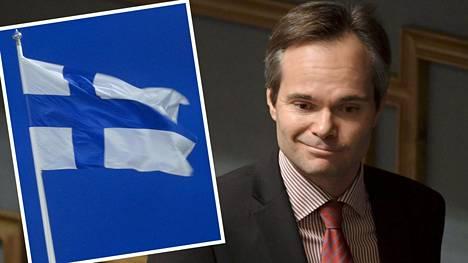 Ministeri Kai Mykkänen liputtaa isänpäivän puolesta.