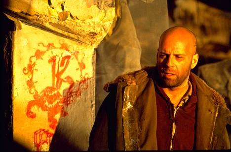 James Cole (Bruce Willis) on vanki post-apokalyptisessa tulevaisuudessa.