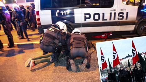 Poliisi otti kiinni neljä ihmistä hakaristilippuihin liittyen. Miehet vapautettiin kuulustelujen jälkeen.