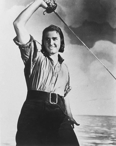 Errol Flynn (1909–1959) on jäänyt historiankirjoille romanttisista miekkailudraamoistaan. Mies eli huoletonta playboyelämää.