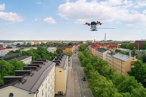 Droneja käytetään nykyään monenlaisissa tehtävissä. Kuvassa Helsingin seudun ympäristöpalvelut lennättää saastemittausdronea Mäkelänkadun yllä.