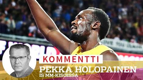 Usain Bolt kiitti yleisöä 100 metrin loppukilpailun jälkeen.