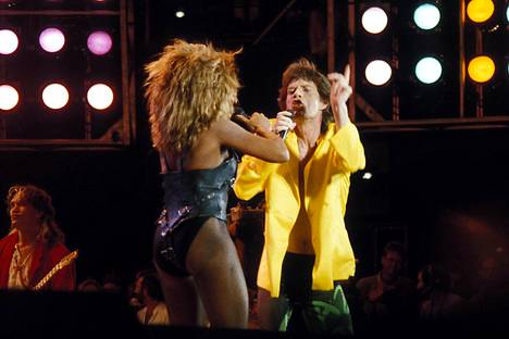 Tina Turner ja Mick Jagger Live Aid -konsertissa vuonna 1991.