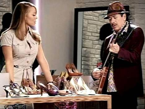 Mariah Carey ja Carlos Santana TV-mainoksessa