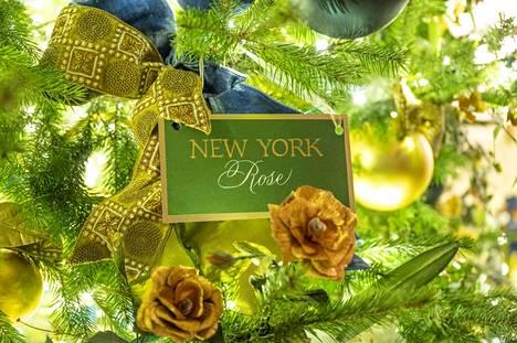 Jokaisella osavaltiolla on joulukuusessa oma paperikukkansa.