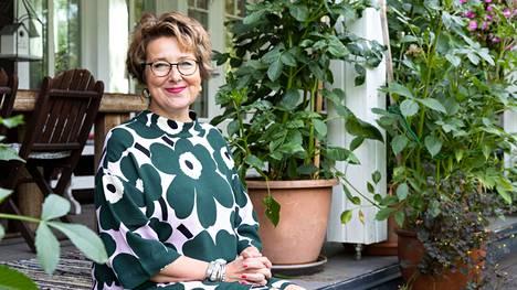 Graafisen alan yrittäjä Sari Rinne on intohimoinen sisustaja ja asuntomessukävijä.