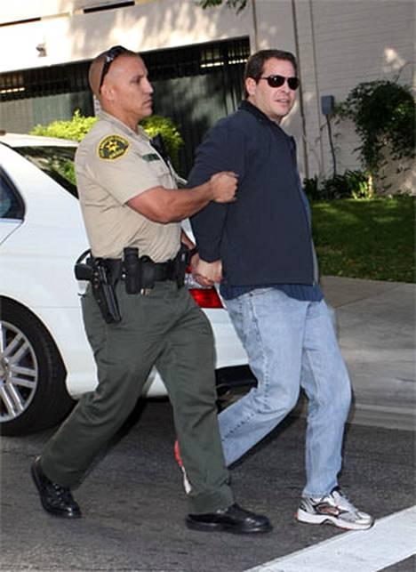 Lindsay Lohanin henkivartija vastusti poliisin tahtoa.