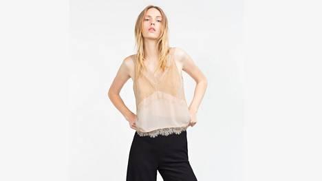 Naisellinen ja aluspaitamainen pitsitoppi tuo lookiin herkkyyttä. Zara.
