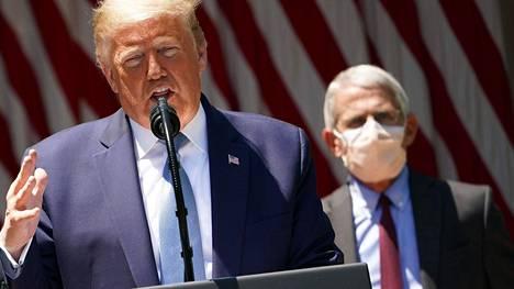 Presidentti Donald Trump ja Yhdysvaltain johtava tartuntatauti-asiantuntija Anthony Fauci.