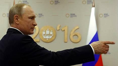 Vladimir Putin ei pitänyt IAAF:n päätöksestä.